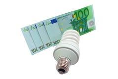 Lampe und Geld Stockfoto