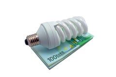 Lampe und Geld Lizenzfreie Stockbilder