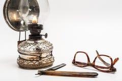 Lampe und Rasiermesser Stockbild