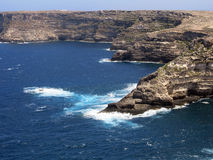 Lampedusa in Italy with Cliff and clean blue sea. Island of Lampedusa in Italy with Cliff and clean sea stock photography