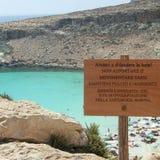 Isola dei Conigli beach. Lampedusa, Italy - September 02, 2002: Information sign at the entrance od Rabbits` beach stock photo