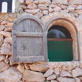 Old house window. Lampedusa, Italy - September 02, 2002: Old house window in Lampedusa Royalty Free Stock Photo