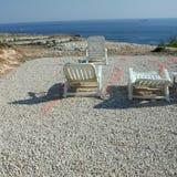 White sunbeds in lampedusa. Lampedusa, Italy - September 02, 2002: Sunbeds in lampedusa royalty free stock photography