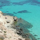 `Isola dei Conigli` beach in Lampedusa. Lampedusa, Italy - September 24, 2002 : View of Rabbits beach from above stock photos
