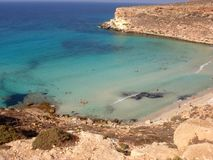 Isola dei Conigli beach in Lampedusa. Lampedusa, Italy - September 24, 2002 : View of Rabbits beach from above royalty free stock photo