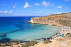 Lampedusa (Sicily) - Rabbits island. This is the magnificent island of rabbits, in Lampedusa. The water is crystal clear and the sand is white. The rocks are Royalty Free Stock Photos
