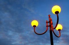 Lampen in de zonsondergang Stock Foto's