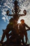 Lampes en bronze sur le pont d'Alexandre III Image stock