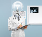 Lamphead doctor writing something. On clipboard Stock Photos