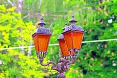 Lampion z pomarańczowym szkłem Fotografia Royalty Free