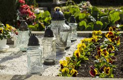 Lampions and flowers, All Saints Day. Flowers and lanterns on graveyard Royalty Free Stock Images
