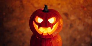 Lampionu dyniowy pomarańczowy światło, Halloweenowy tło fotografia stock