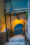 Lamplight and steep steps Stock Photo
