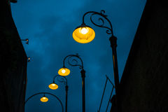 Lamplight and steep steps Stock Image