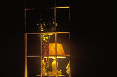 Lamplight in window of home at night,  Bourbon, MO Royalty Free Stock Photos