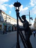 Lamplighter city. Monument guardian of the city lights on the street Piotrkowska in Lodz Stock Image