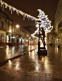 Lamplighter street. Polish city. Monument of Lodz and Christmas lights lighthouse Piotrowska Street in Lodz Stock Photos