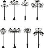 Lampor en vektor av svart färg, gatabelysning, mönstrar på en lyktstolpe, tappninglampor, Royaltyfri Bild