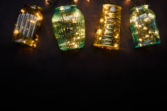 Lampor för julljus över mörk bakgrund Arkivbilder