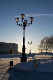 Lampost with Snow and Sun in Background Stock Image