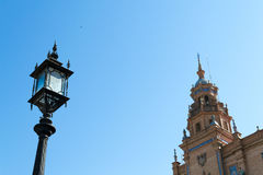 Lampost and tower at Spain square Royalty Free Stock Photo