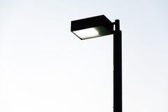 Lampowa ulica, elektryczność przemysł na białym tle Obrazy Stock