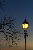 Lamppost στο ηλιοβασίλεμα Στοκ Εικόνες