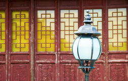 Lamppost. The classic lamppost in temple with antique door as background Stock Image