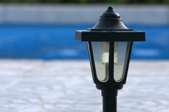 Lamppost. Of garden Stock Photo