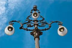 Lamppost adornado con tres lámparas en Génova Imágenes de archivo libres de regalías