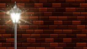 Lamppost with bright light on brick wall Royalty Free Stock Image
