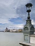 Lamppost in the Chains Bridge. View of the Danube River from the famous Chain Bridge in Budapest, with a lamppost included in the foreground of the composition Stock Image
