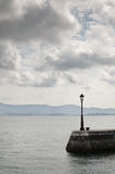Lamppost on the Coastline. Lamppost on a pier in northern Spain Royalty Free Stock Images