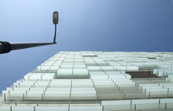Lamppost, cristial and sky. Lamppost, glass building and sky Royalty Free Stock Photography
