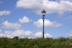 Lamppost on a dike Stock Photography