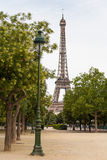 Lamppost with Eiffel tower in the background Royalty Free Stock Photography