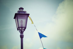 Lamppost and flags Royalty Free Stock Photography