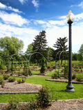 Lamppost. In a formal rose garden Royalty Free Stock Photo