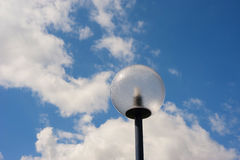 Lamppost in front of a cloudy sky. Modern spherical lamppost in front of a cloudy sky Royalty Free Stock Photo
