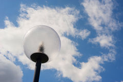 Lamppost in front of a dramatic sky. Modern spherical lamppost in front of a dramatic sky Stock Image