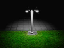 Lamppost at hight. Lonely black and white lamppost in darkness Royalty Free Stock Photography
