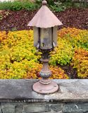 Lamppost. The house Garden full of flowers Royalty Free Stock Image