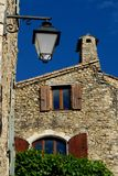 Lamppost and house silhouetted against the blue sky in Mirmande in France Stock Photos