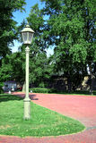 Lamppost on a lawn and footpath near Peter and Paul Fortress in Saint Petersburg Royalty Free Stock Photos