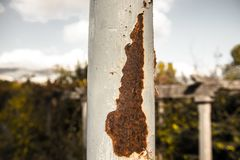 Lamppost. Light blue antique lamp post with rust Stock Photography