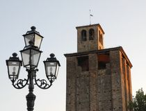 Lamppost and medieval tower in Piove di Sacco a town in the province of Padua located in Veneto (Italy) Stock Photo