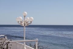 Lamppost by the ocean. Beautiful lamppost by the ocean in Italy Royalty Free Stock Photo