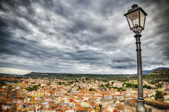 Lamppost over Bosa buildings on a cloudy day Stock Photos