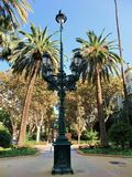Lamppost in a park. A lamppost in one of the many parks of Valencia Spain royalty free stock photos