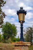 Lamppost in park. With cloudy sky Royalty Free Stock Photos